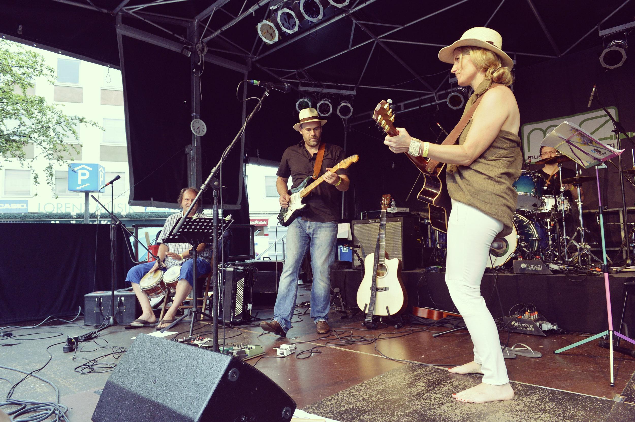 Samantha Stollenwerck and band playing Nuremberg, Germany, Bardentreffen Festival.