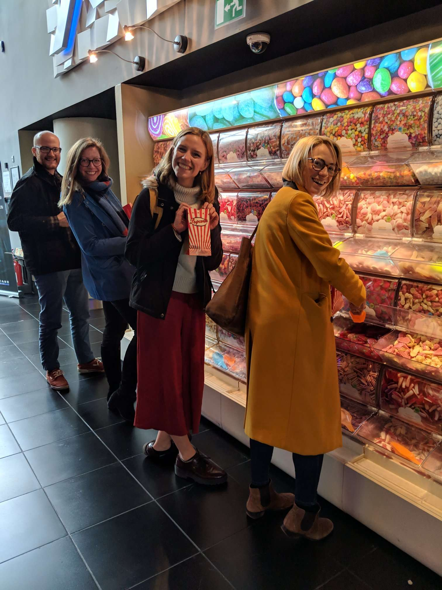 A trip to the cinema calls for pick-n-mix… From left: Jacob (MWC Intern), Sara (Policy Projects Manager), Noa (Communications Officer), and Katrina (Director). 📷: Harriet (Project Manager).