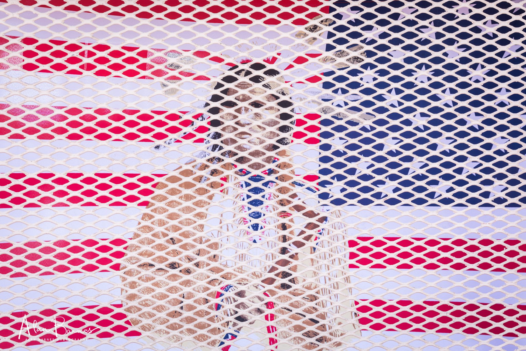 Walking around the outside of the building I saw this flag behind some window grids and thought it was a very symbolic image of the Native American status.