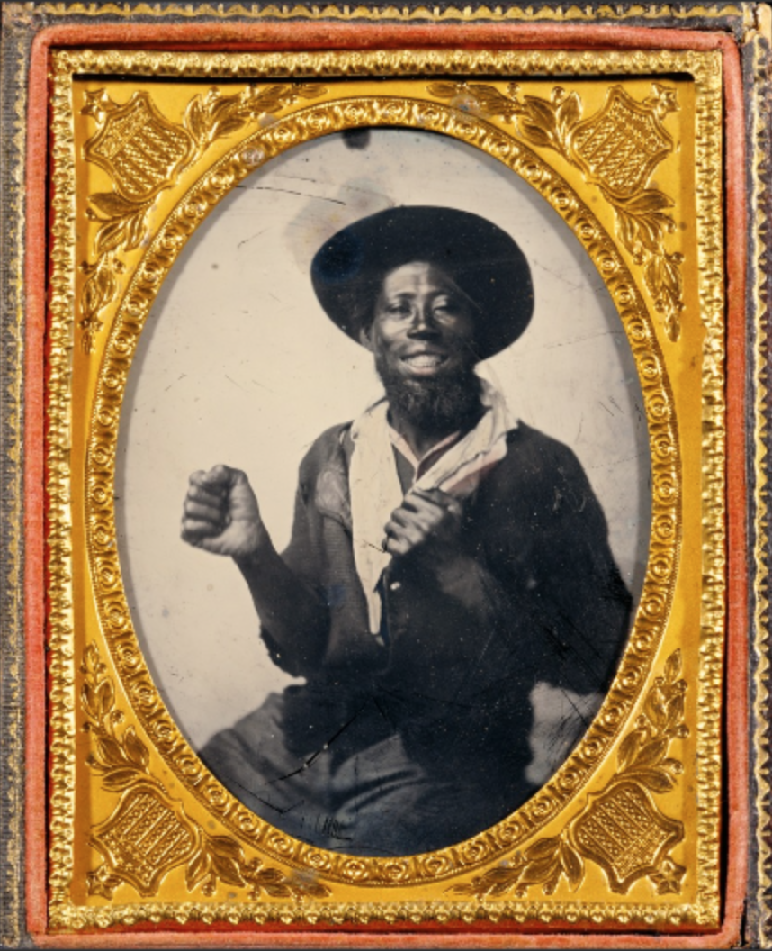 Earliest Known Images of People Smiling, Ambrotype portrait of an African American man striking a boxing pose (source)
