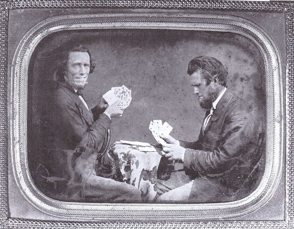 Earliest Known Images of People Smiling, Ambrotype self-portrait of Isaac Wallace Baker playing cards, c. 1853 (source)