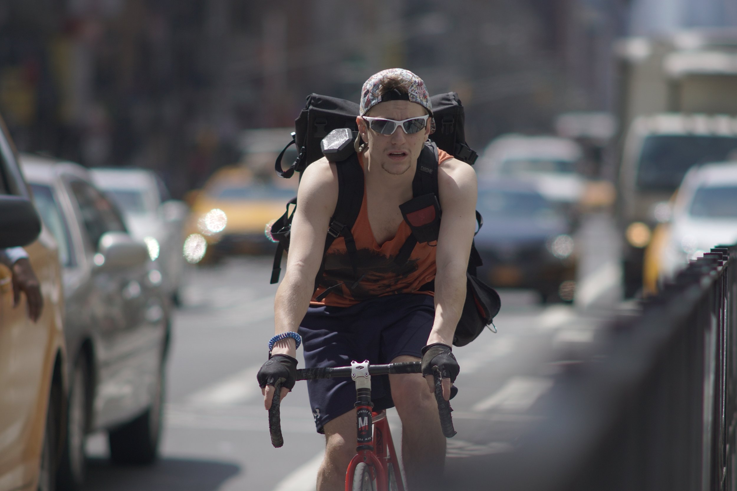 Street Photography with A Telephoto Lens, bike messenger