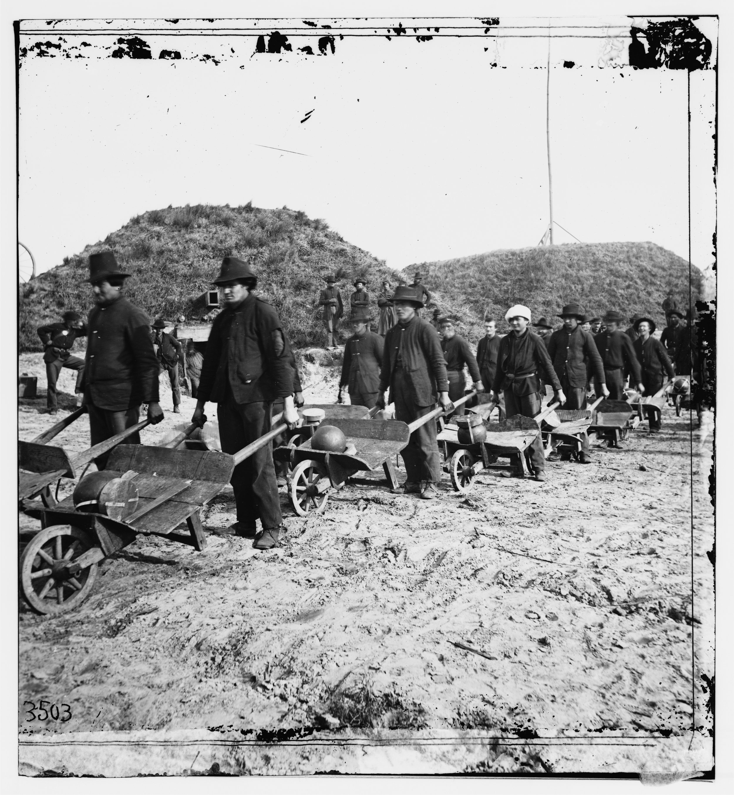 Earliest Known Images of People Smiling, Union soldiers moving artillery shells with wheelbarrows in Fort McAllister, Georgia, by Samuel A. Cooley, 1864