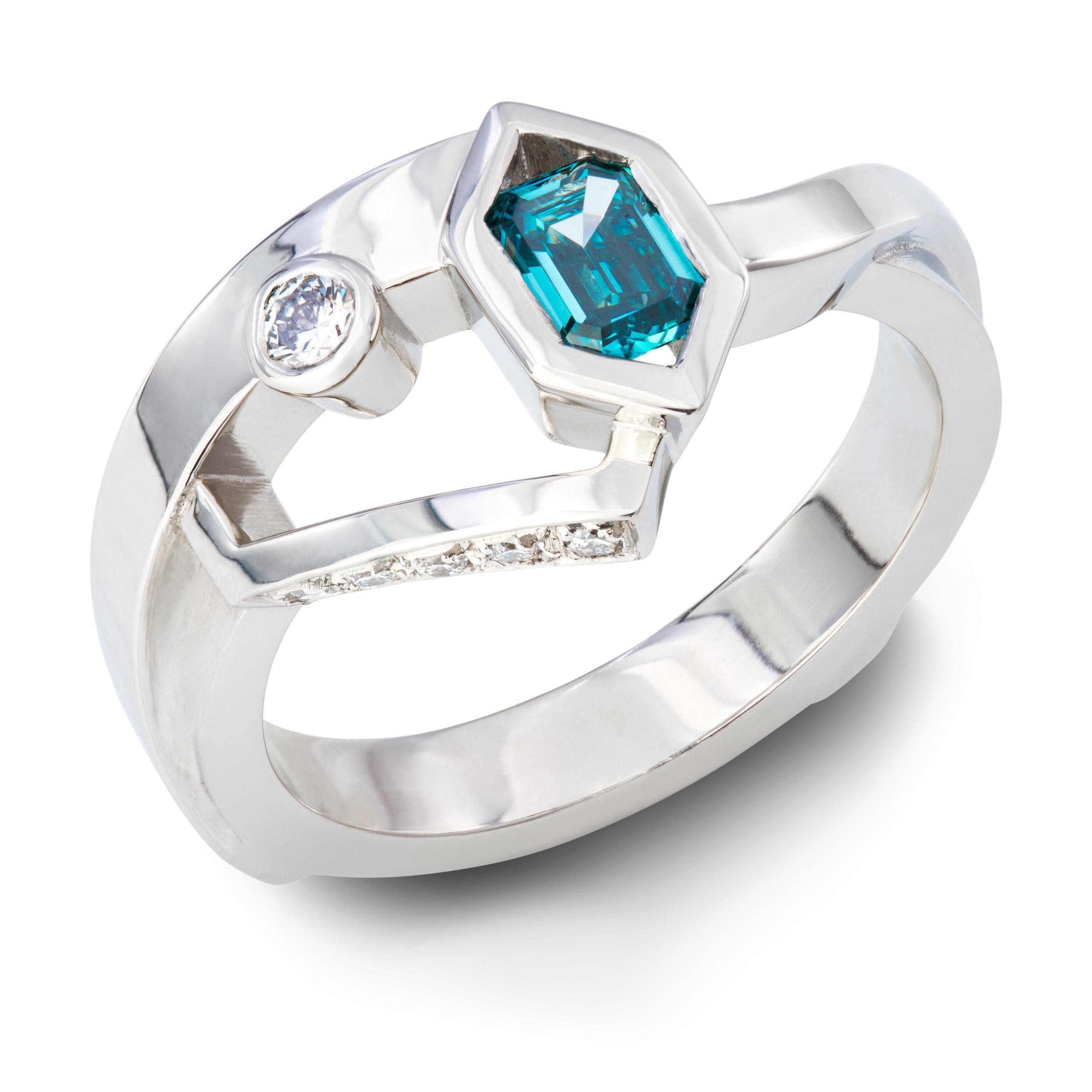 Platinum ring set with one octagonal treated blue diamond and six round brilliant cut diamonds - £3,270