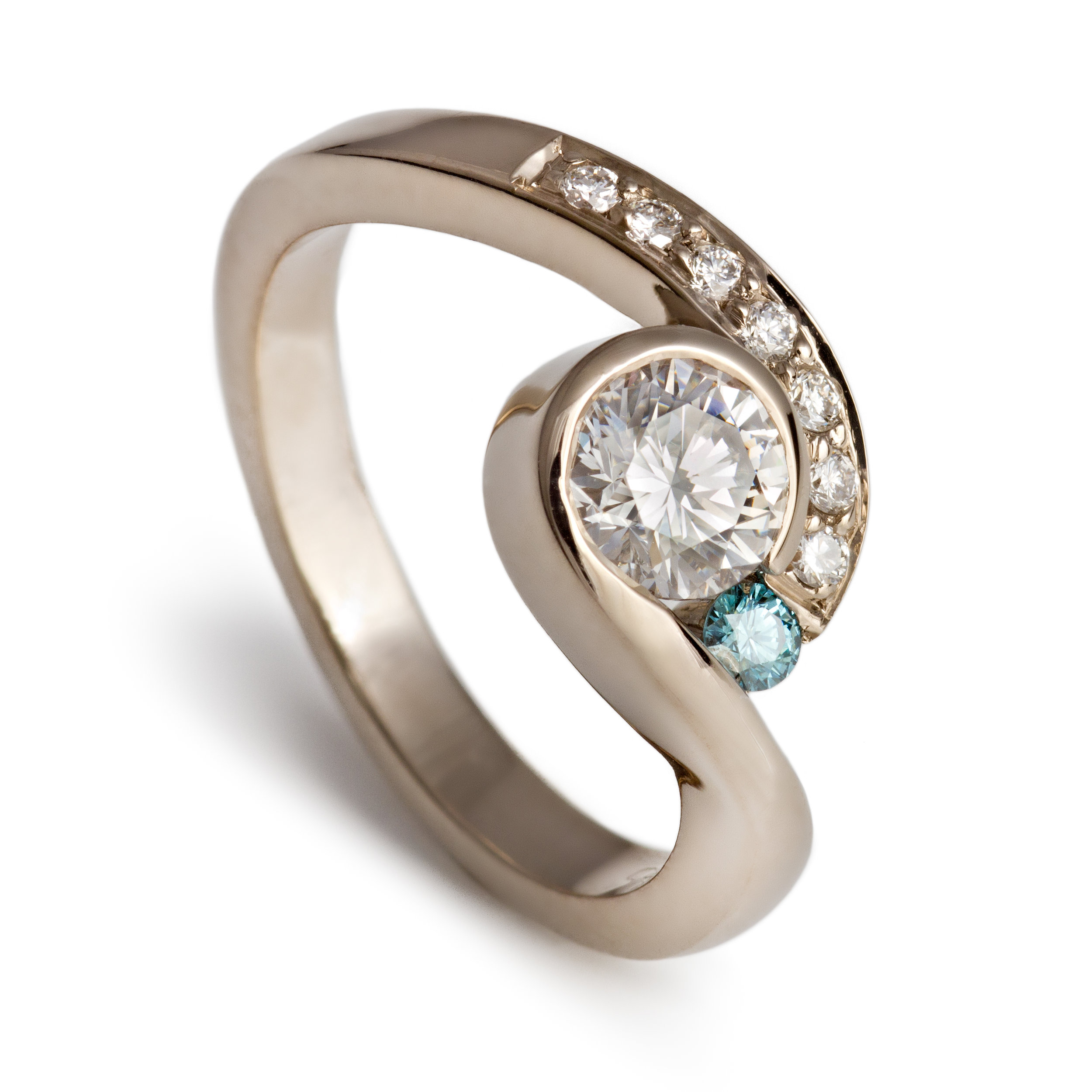 18ct white gold engagement ring set with one central round brilliant cut diamond, one treated blue diamond and seven round brilliant cut diamonds - £4,975