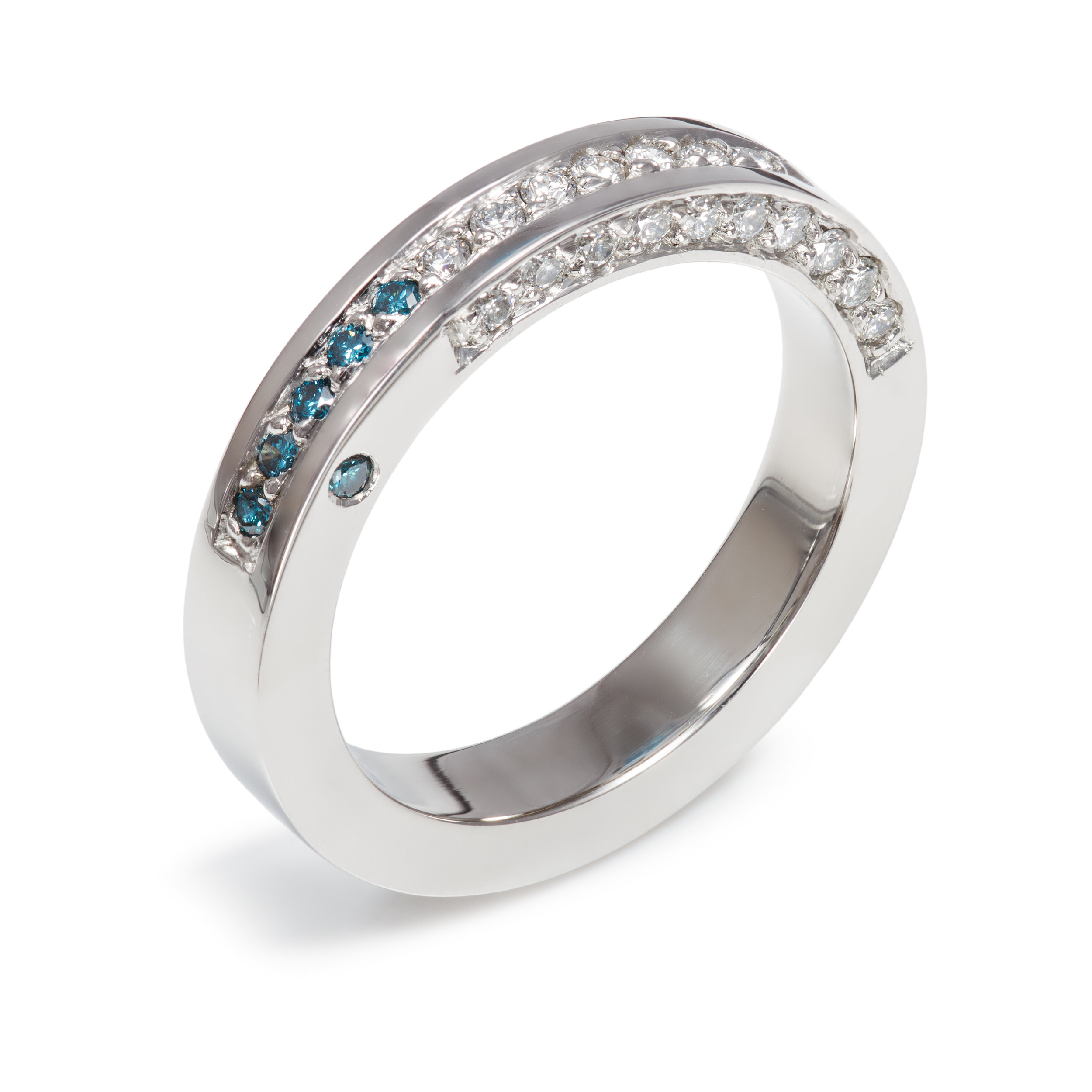 Platinum ring set with seventeen round brilliant cut diamonds and a further six treated blue diamonds - £3,325