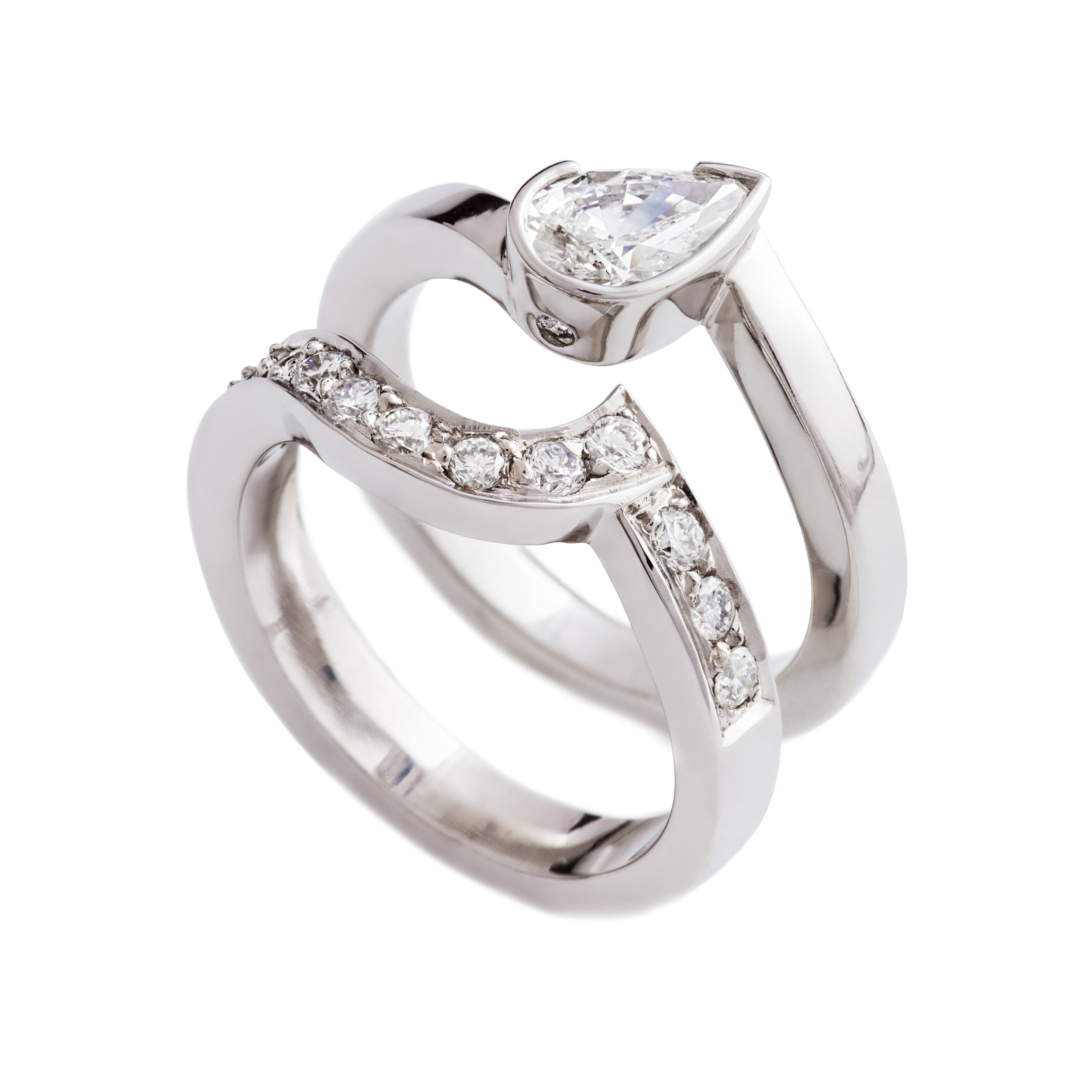 18ct white gold pear shaped diamond engagement ring with hidden diamond on setting - £5,454 18ct white gold fit-in wedding ring set with twelve diamonds - £2,258