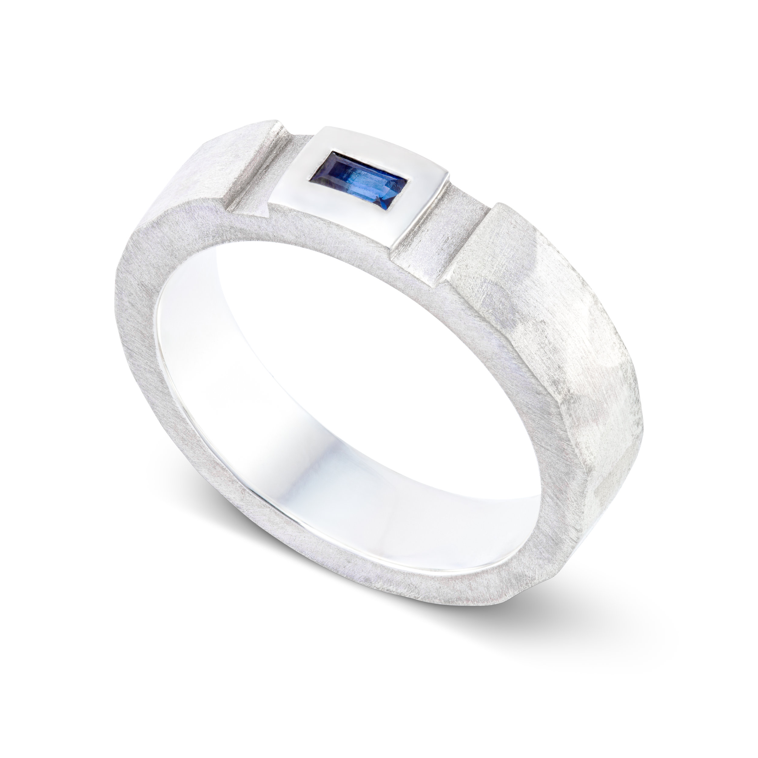 Silver dress ring set with one baguette sapphire - £190