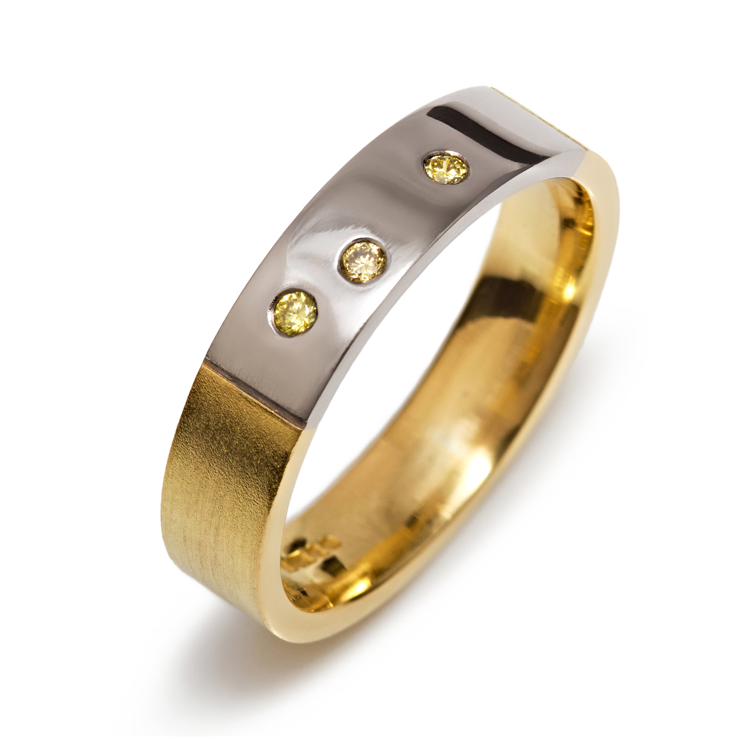 18ct yellow and white gold ring set with three natural yellow round brilliant cut diamonds - £1,195