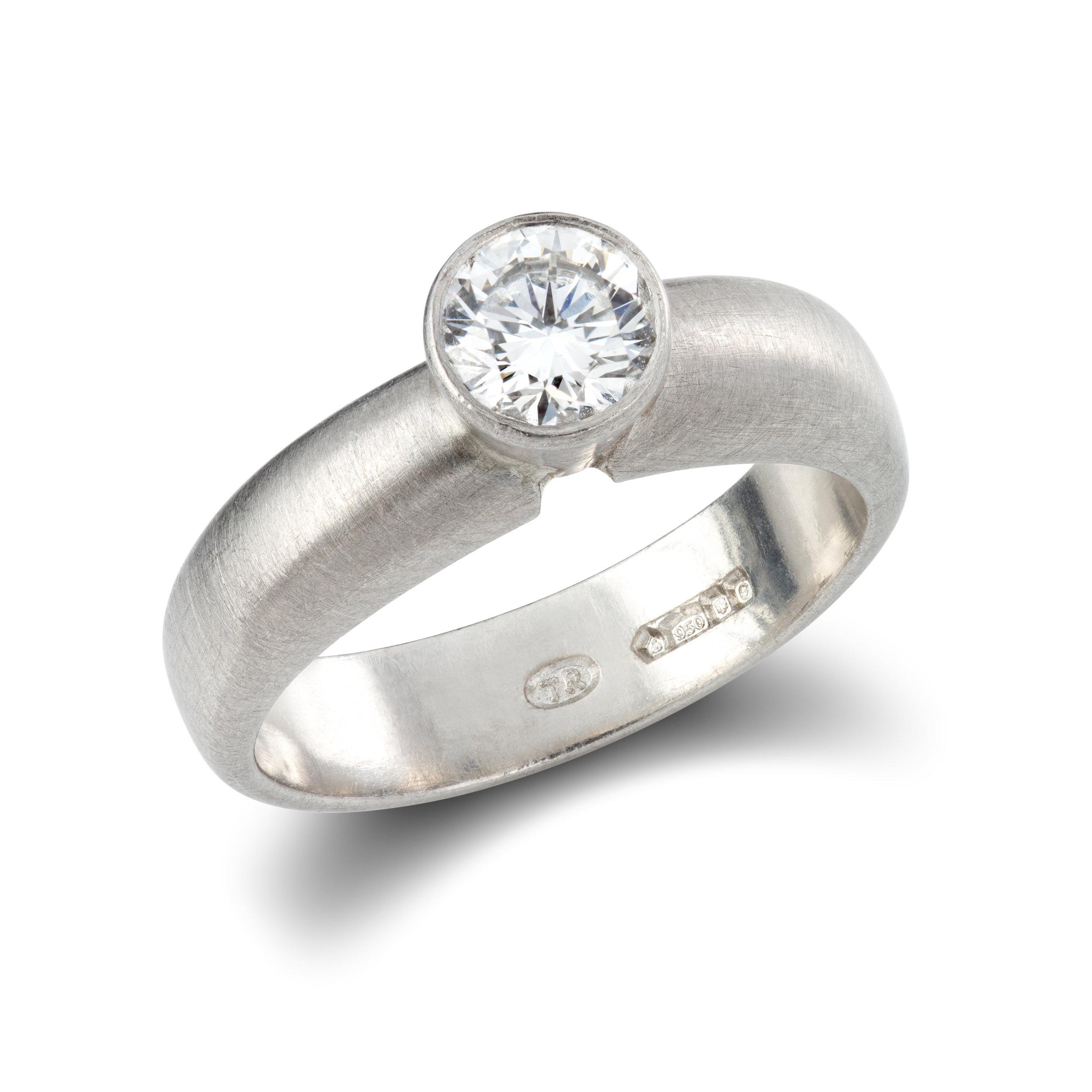 Platinum engagement ring set with one round brilliant cut diamond - £3,859
