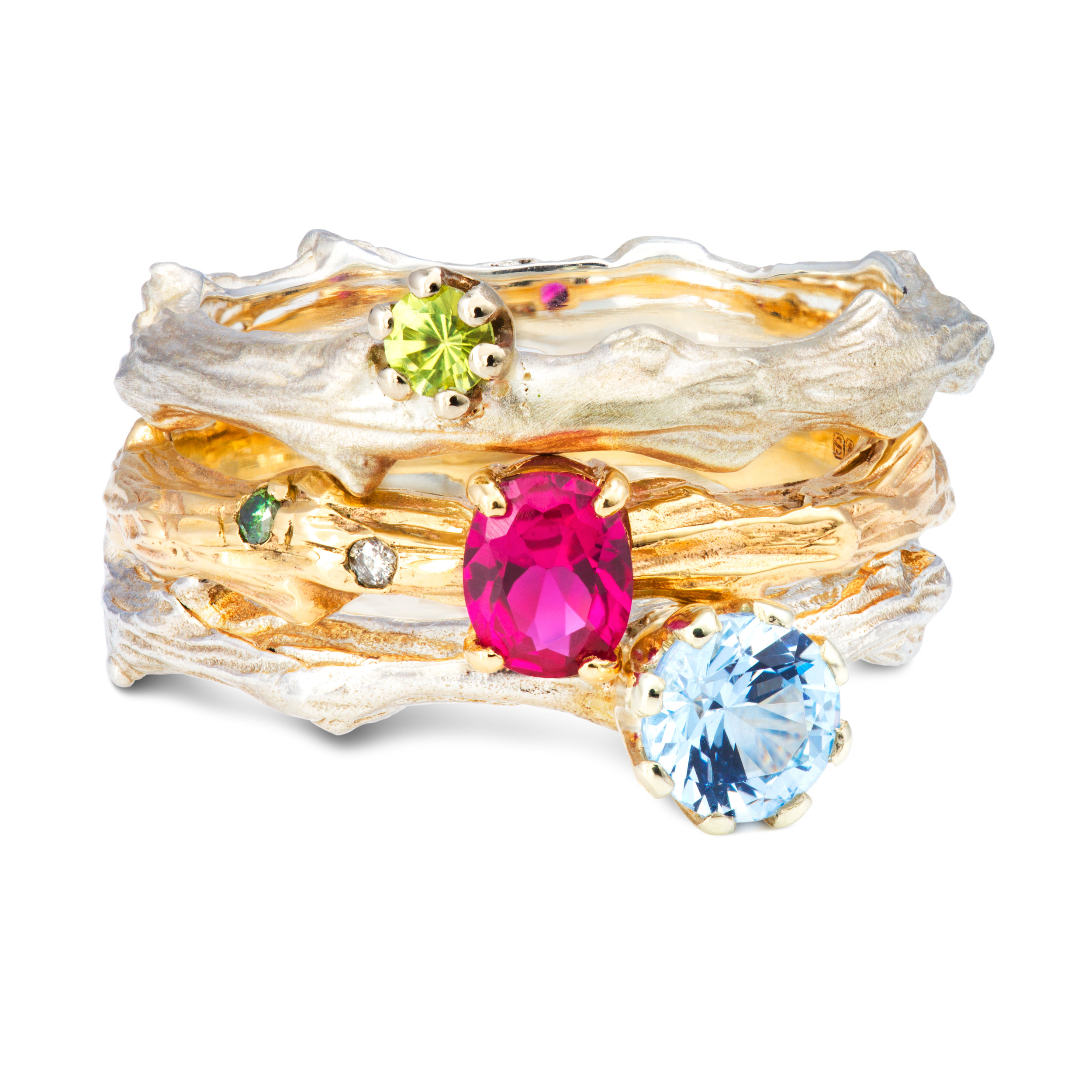 From the top: Silver & peridot ring - £235 9ct yellow gold, lab-created ruby & diamond ring - £545 Silver & lab-created blue spinel ring - £270