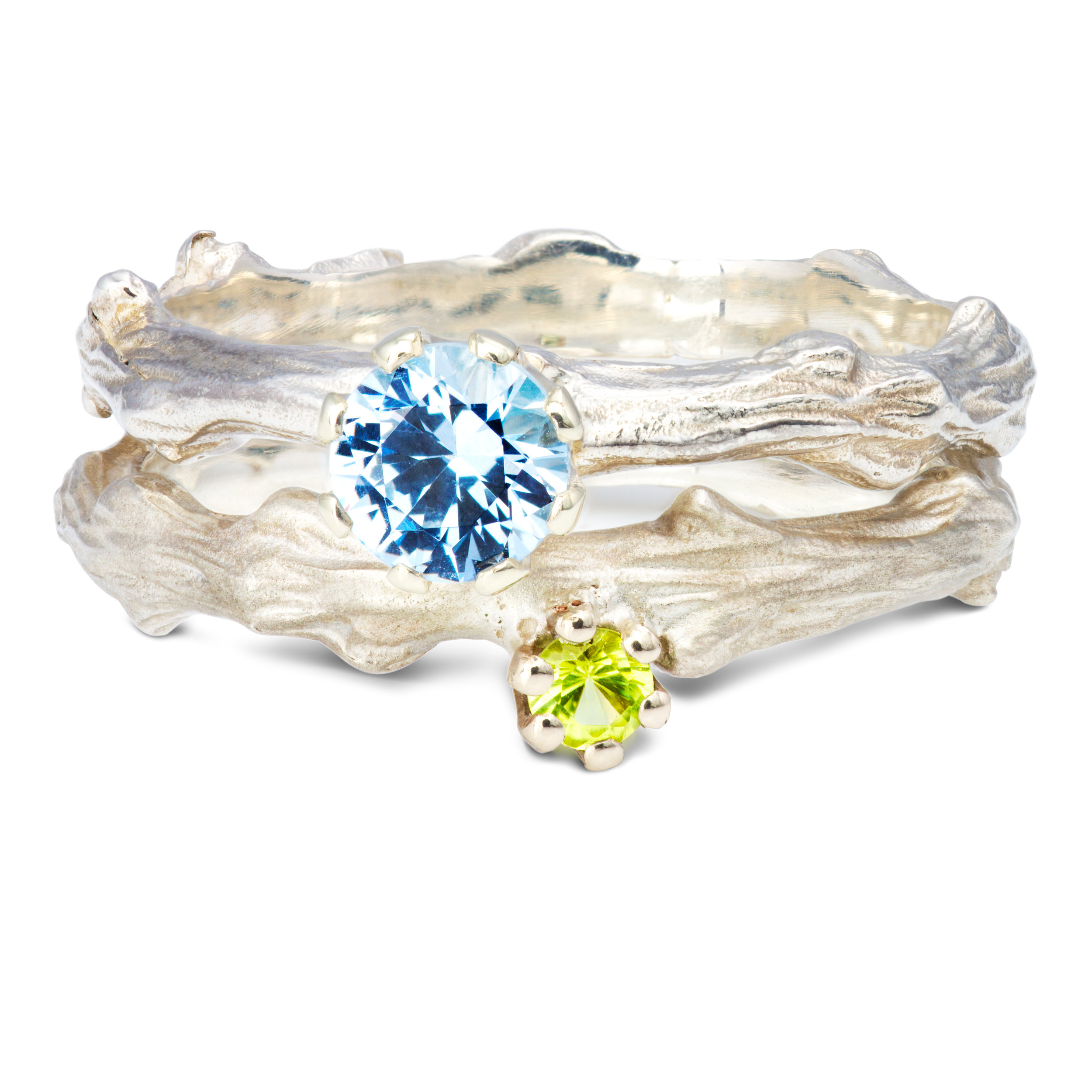 From the top: Silver & peridot ring - £235 Silver & lab-created blue spinel ring - £270