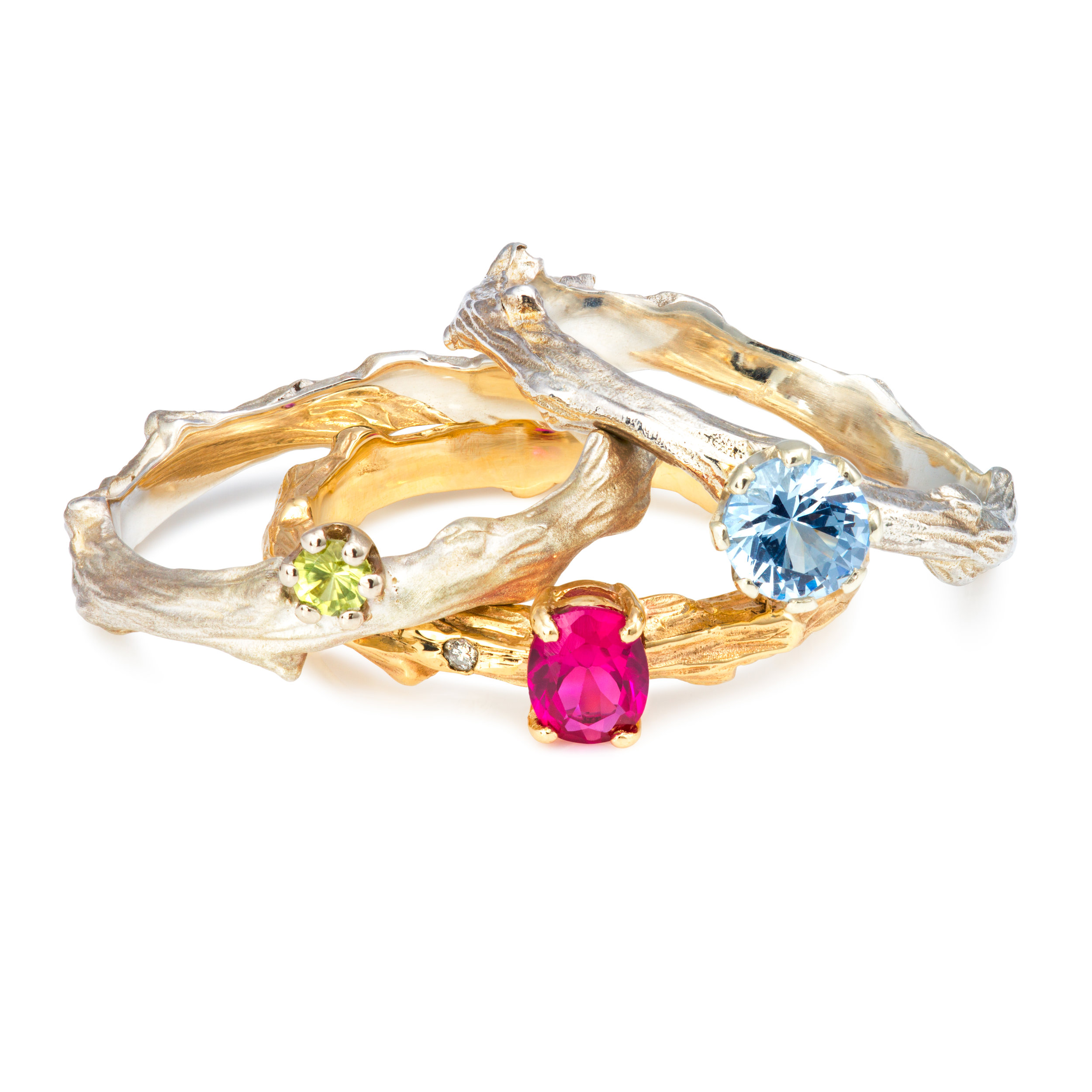 From left to right: Silver & peridot ring - £235 9ct yellow gold, lab-created ruby & diamond ring - £545 Silver & lab-created blue spinel ring - £270