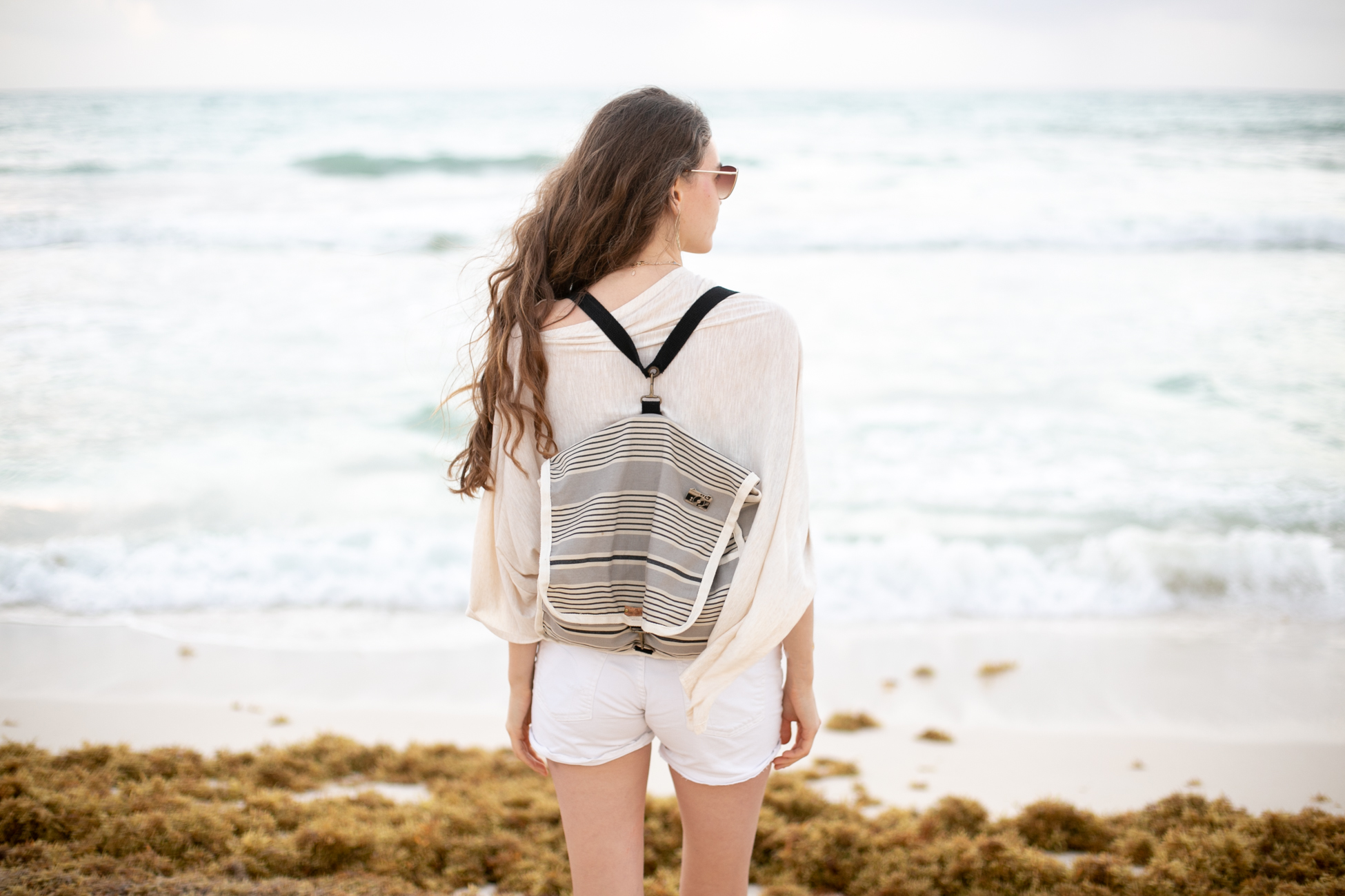 At the beach featuring  West Oak's  backpack,  TogTees  audiovisual pin,  Carolyn Keys  earrings and  Wild Mantle's  poncho.