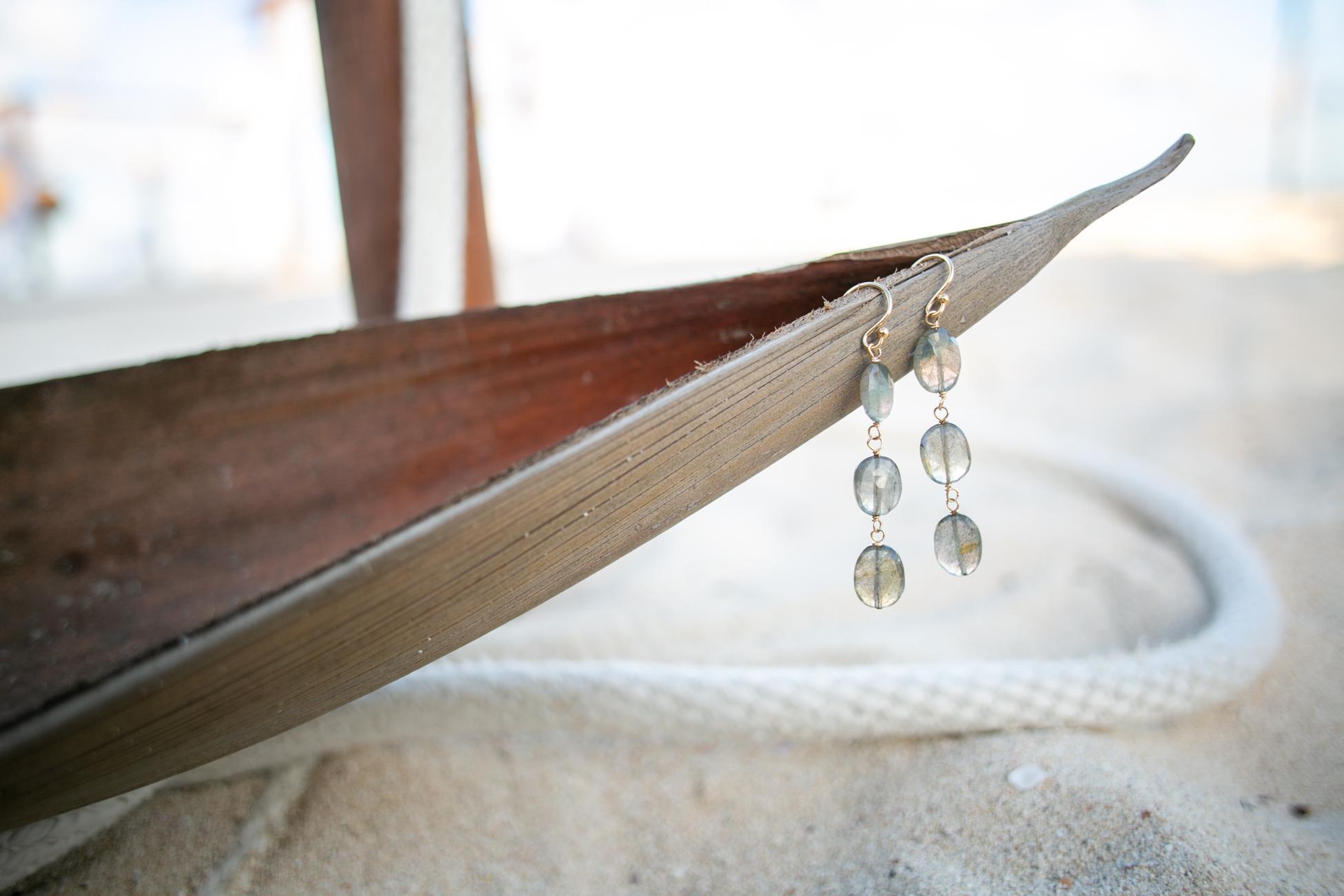 Sarah Cornwell's  earrings on a palm tree boat.