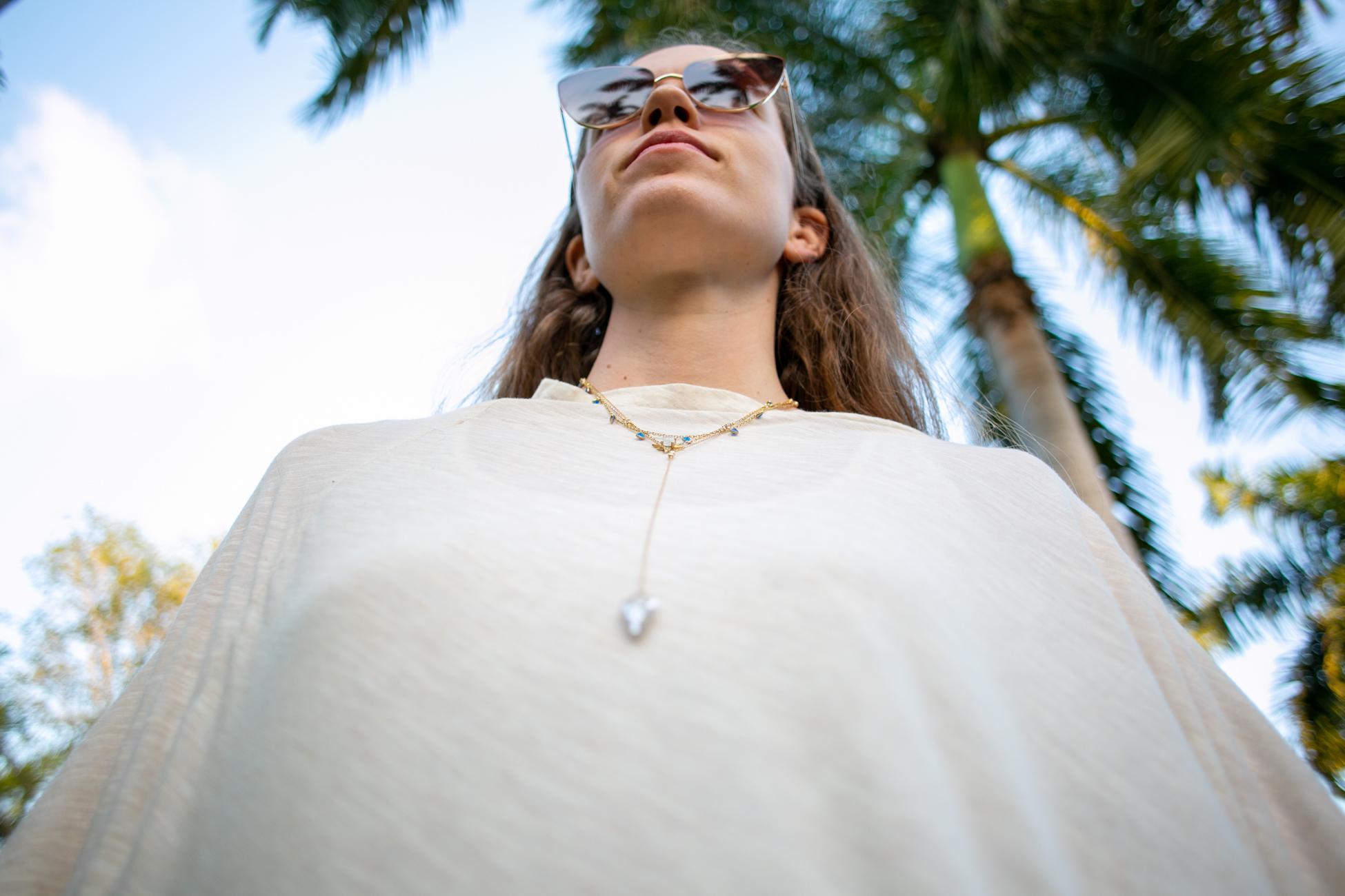 Emily Kiefer  (necklaces) x  Wild Mantle  (poncho)