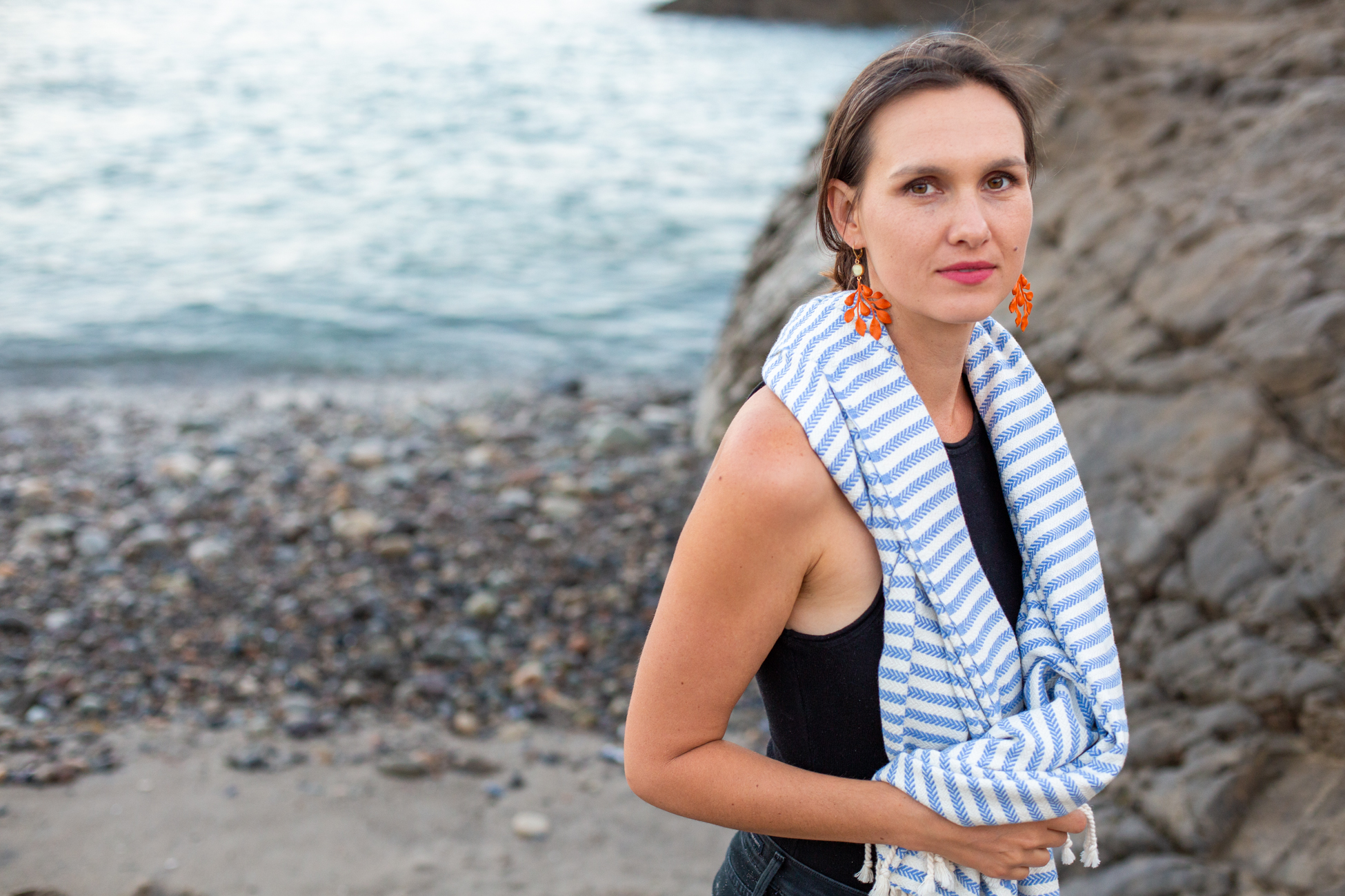 Fig. 5 Collab between Together Textiles (turkish towel) and joeyfivecents (earrings) at sunset on Leo Carrillo State Park beach.
