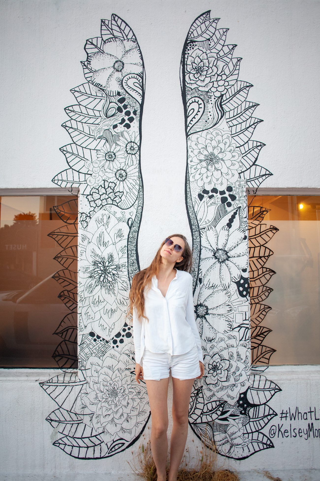 Fig. 18 This is me  doing something that trends  on Abbot Kinney #WhatLiftsYou mural by  Kelsey Montague