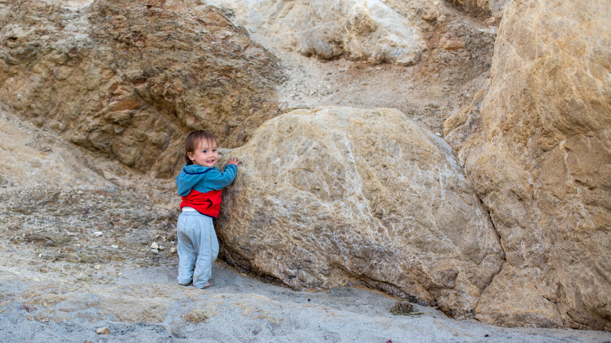 "Fig. 26 Our behind-the-scenes Creative Director: ""Oh hi mom, I'm not trying to climb these rocks of anything!"""