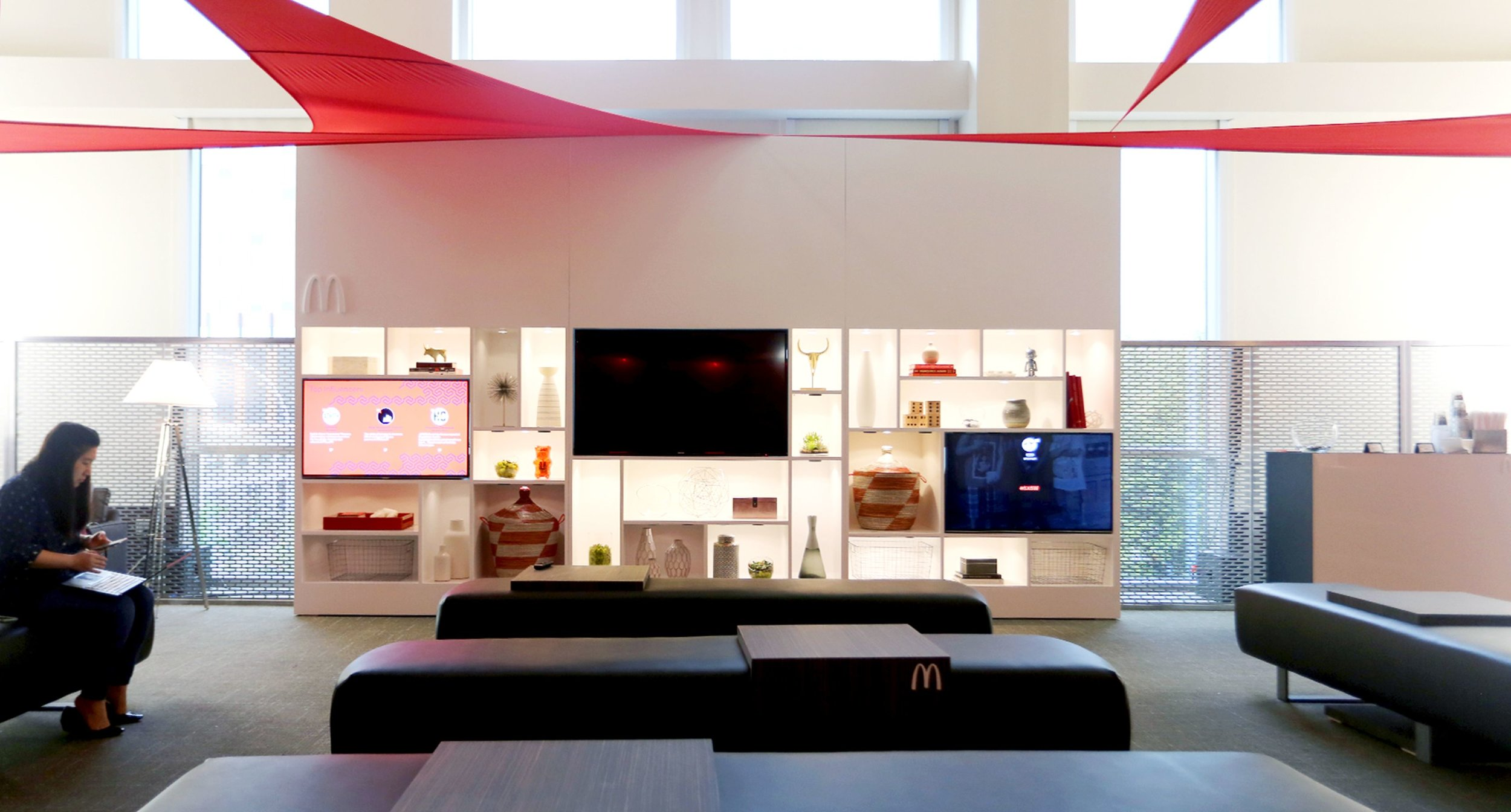 McDonald's Lounge with television and decorated shelves