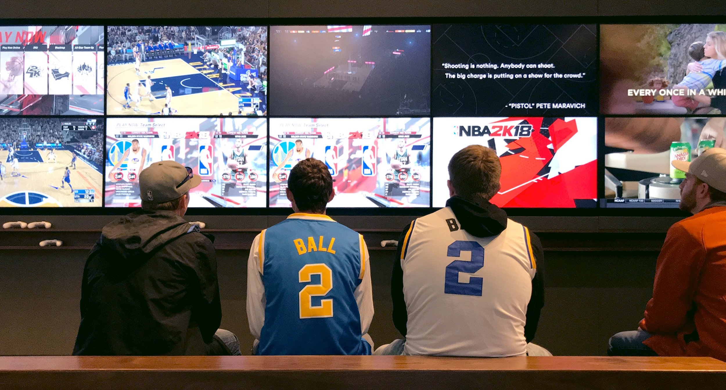 Photo of fans in the Home Court lounge watching sports