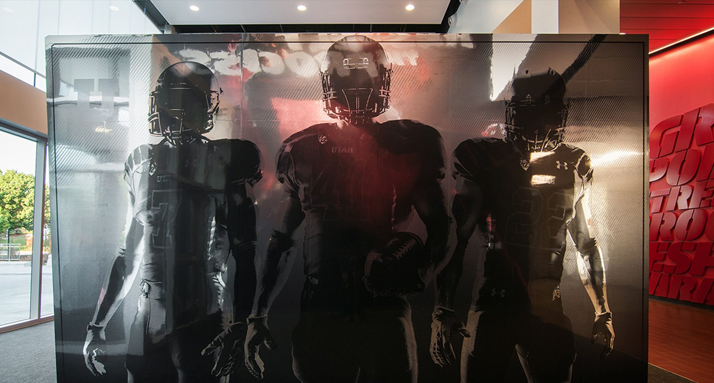 Three Football Players on Grey See-through Background