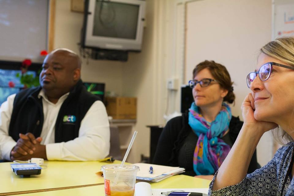 Marcus Wilson (left) and Pam Christianson (right), passionate advocates for children and trauma-responsive schools working at the Anchorage School District, listen to Northwood Elementary principal Deanna Beck, along with the Northwood school counselor (middle), who is an integral part of creating safe, empowering, trustworthy, and collaborative schools.