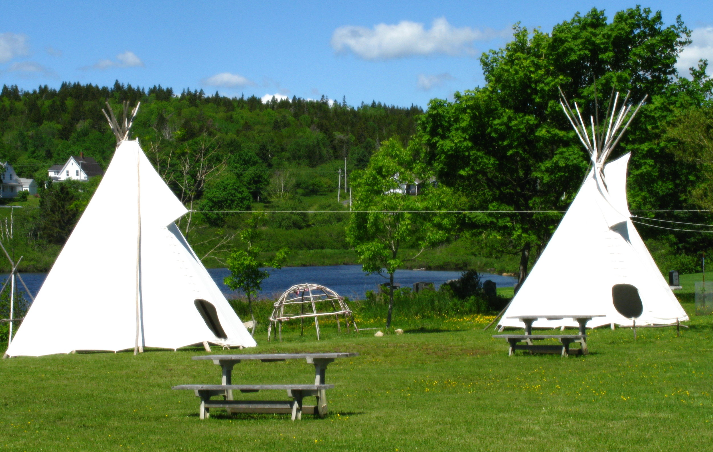 The museum grounds celebrate Mi'kmaq heritage with a small interpretive village including a teepee, communal fire setting, and native plant medicine knowledge. Local Mi'kmaq community members often sell and showcase many of their traditional crafts at our heritage events.