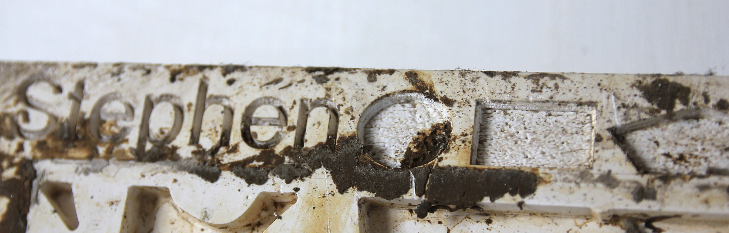 Laser etching onto plaster, as a cast for the clay (this is a photograph taken later on, so excuse the mud).