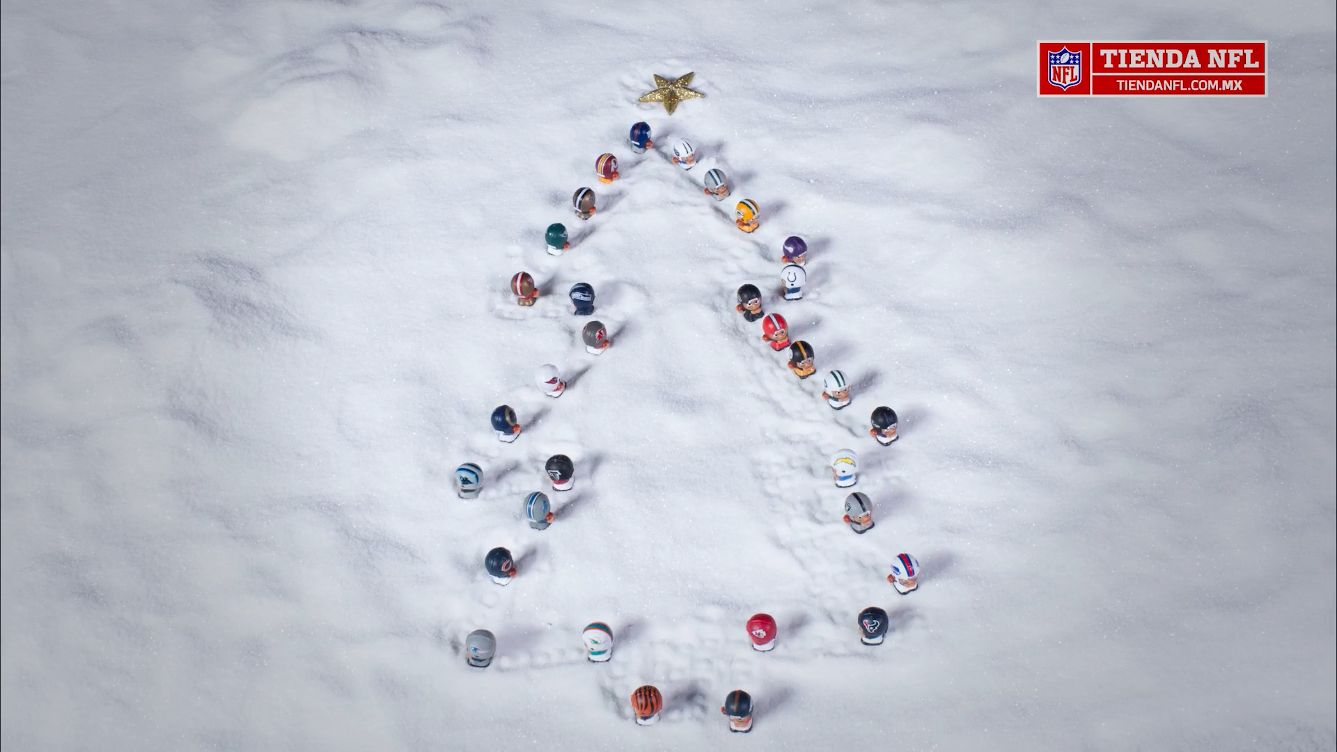 The NFL toys make a Christmas tree in the snow.