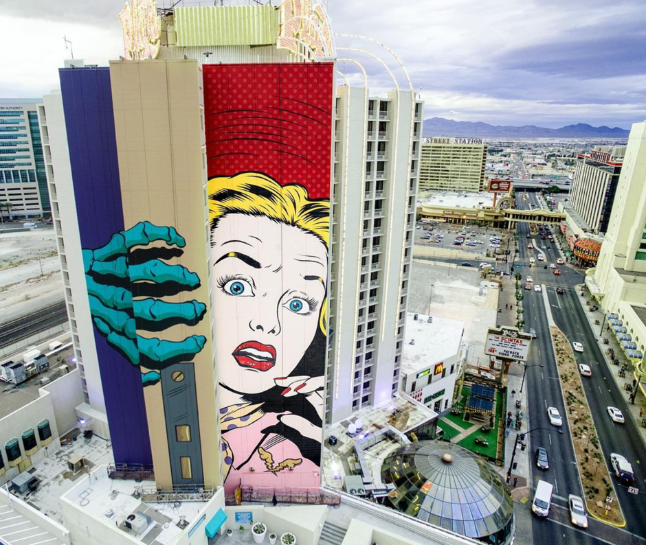"""""""This is our favourite piece with DFace out in Las Vegas. It took 3 of us 7 days to complete. It is our biggest mural to date and I love the concept and the fact that it is a door edge...so when the sun moves it creates a real life shadow across her face!"""" - Spraying Bricks"""