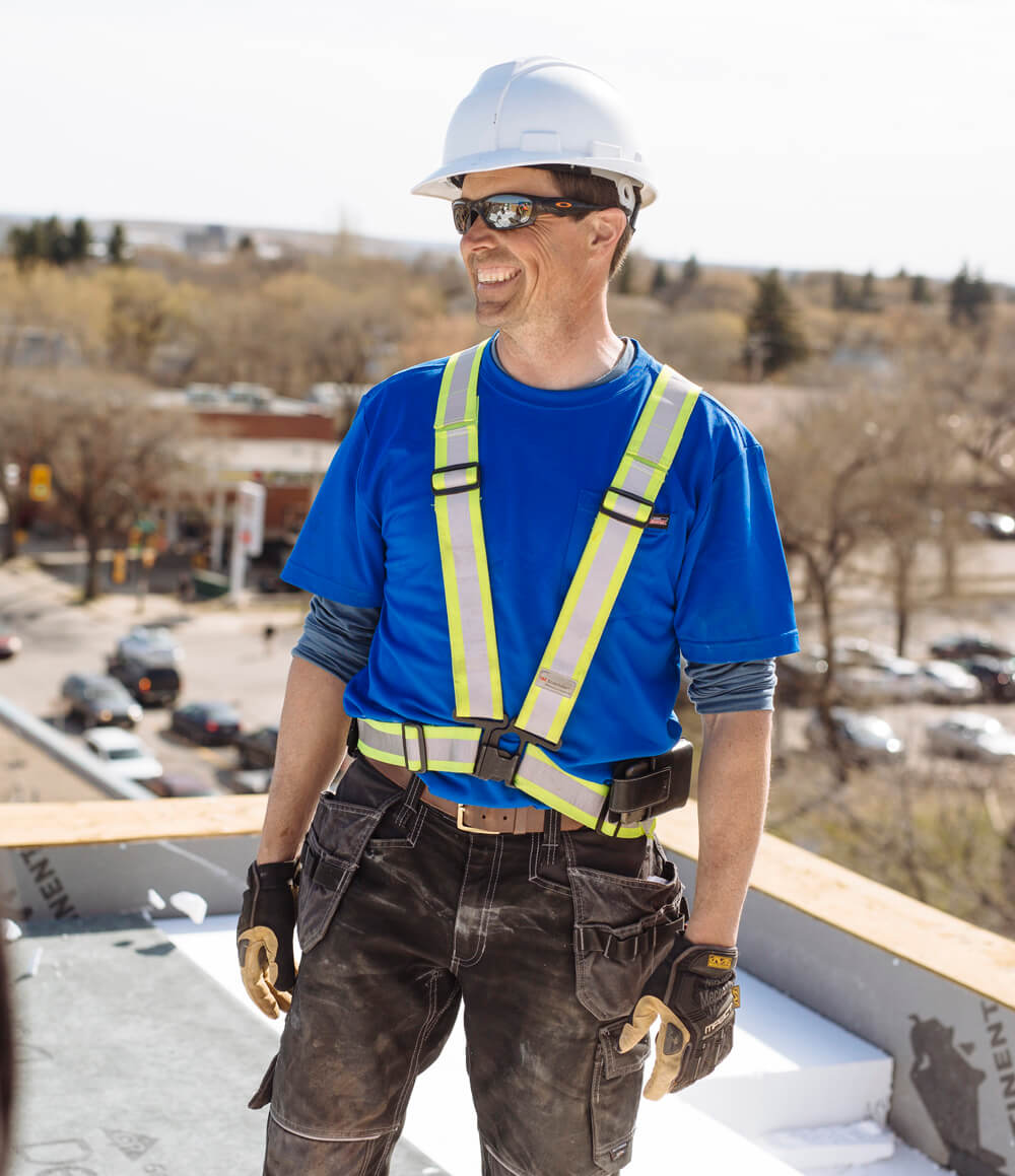 Professional roofer reading instructions
