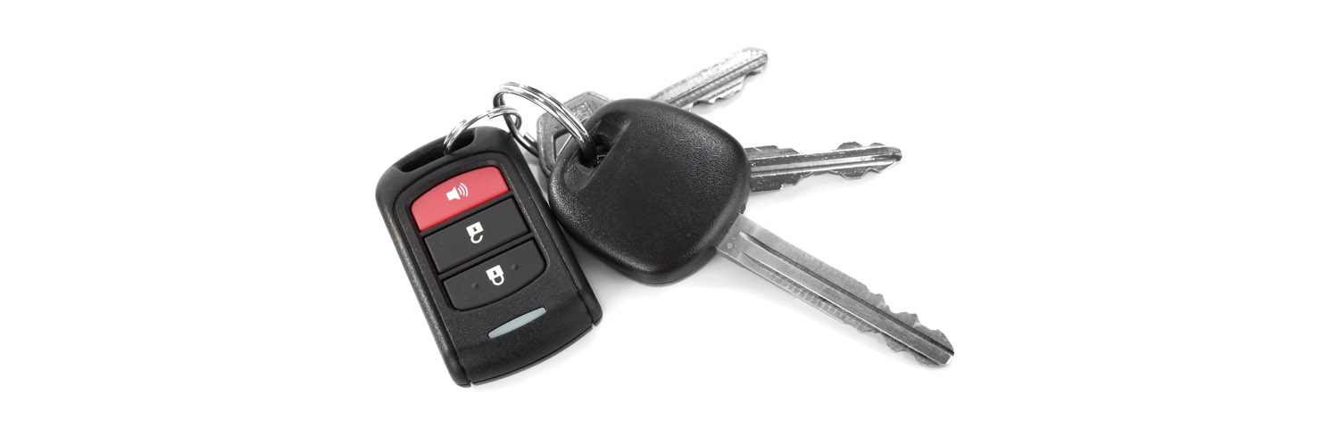 Key ring with remote car door opener, car key and two other keys
