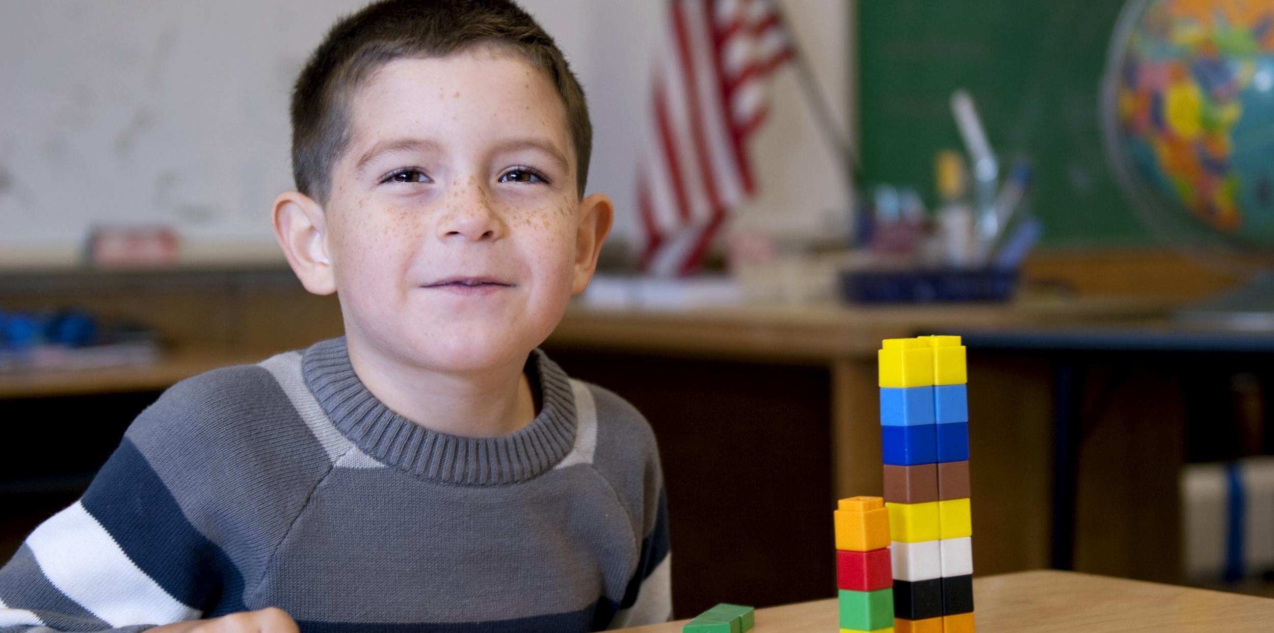 Boy with math manipulative blocks