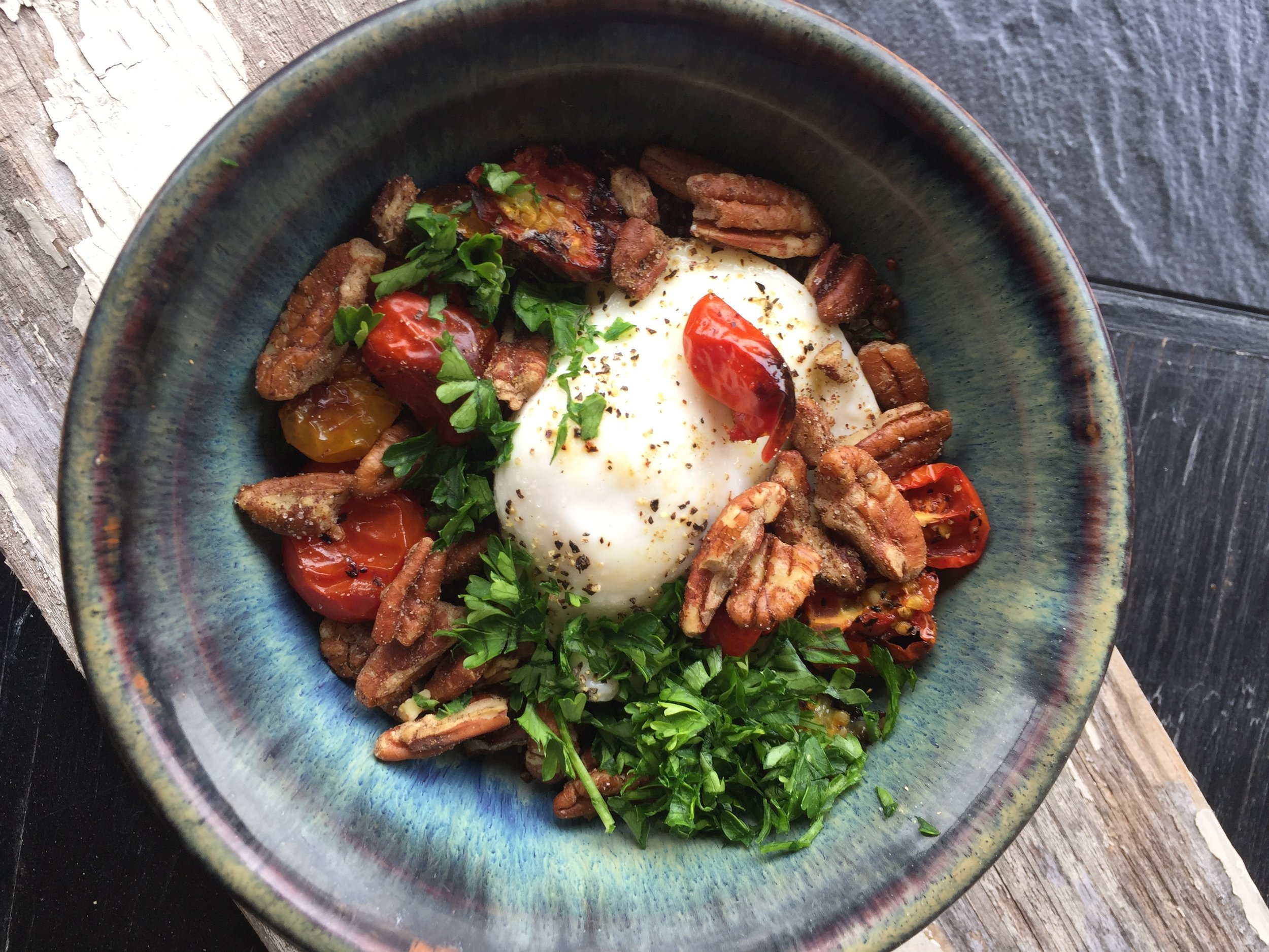 Poached Egg over Quinoa Roasted Tomatoes and Zaatar Pecans