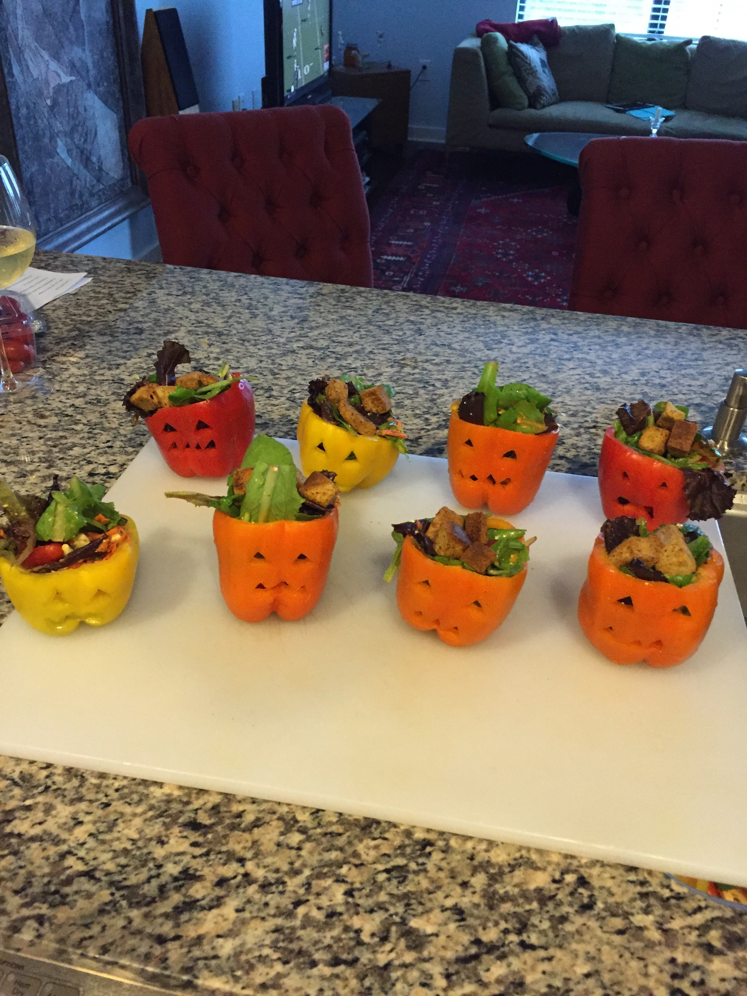 Salads In Carved Out Jack O' Lantern Peppers