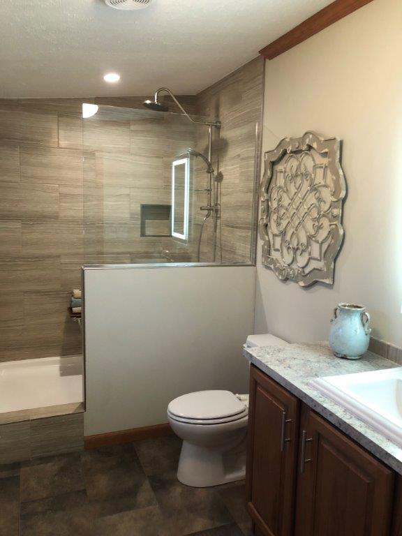 Riverview 208 Master Bath with optional walk-in shower.jpg