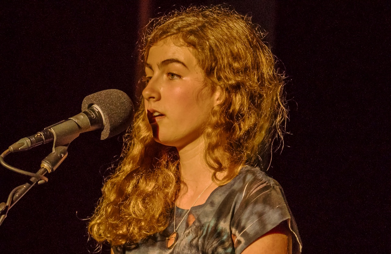 Young poet Natalie Frederick performs an original poem about her political awakening this year.Photo by Martha Ture.
