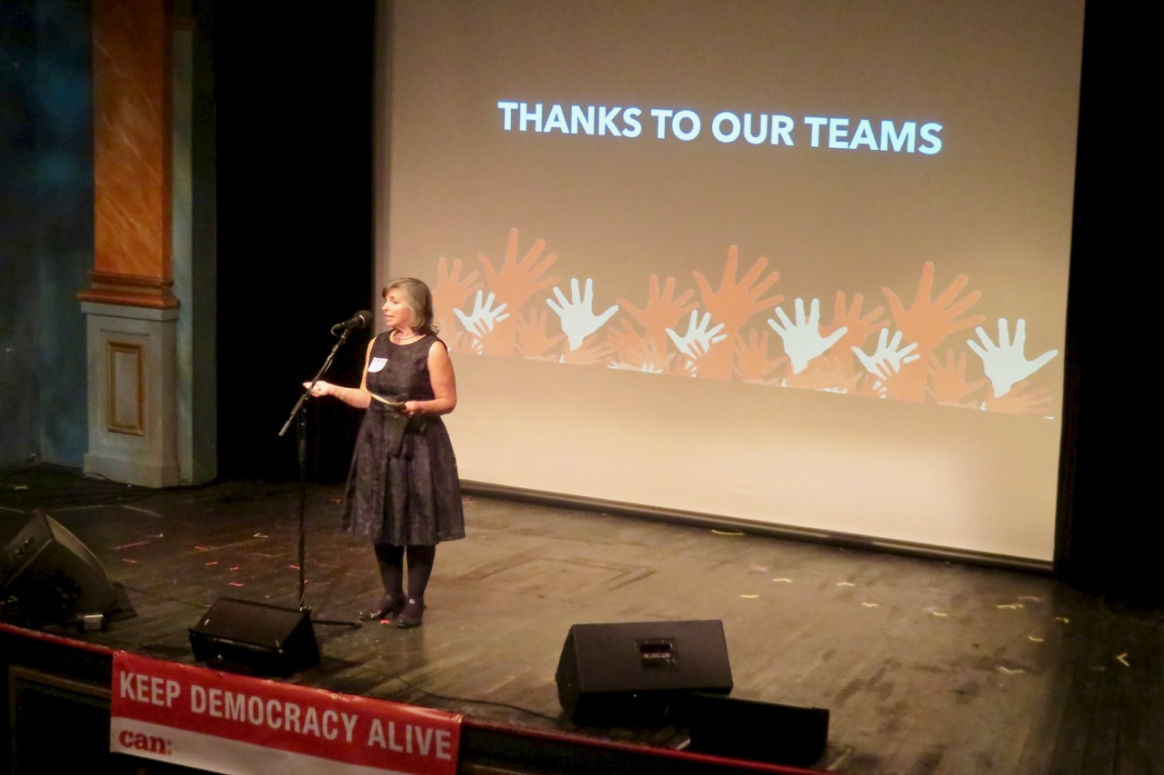 Activist and MVCAN leader Suz Lipman thanks our action teams at the MVCAN-Do-Revue.  Photo by George Osner.