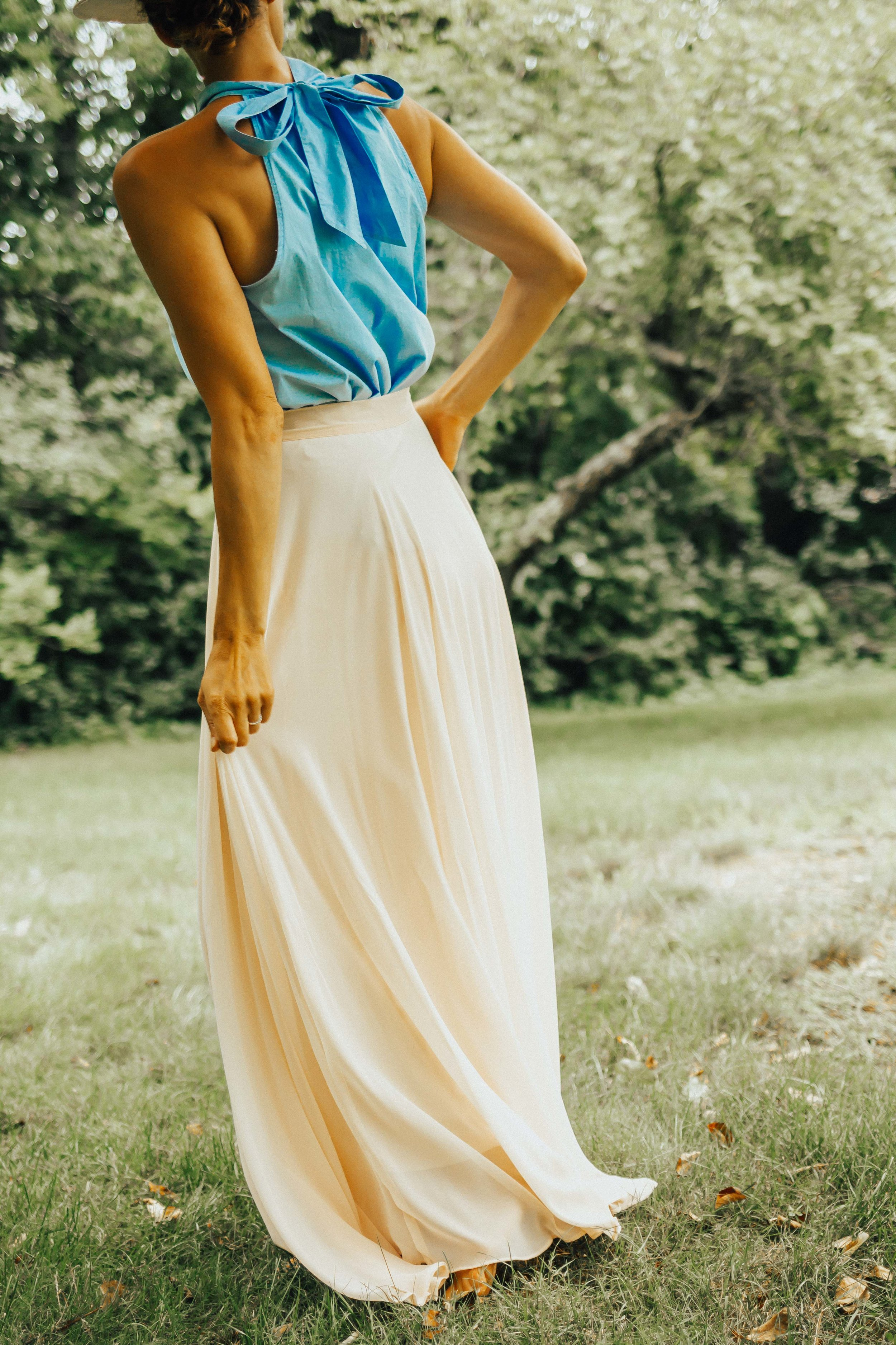 OUTFIT DETAILS - PINK MAXI SKIRT(in blue & yellow)NECK TIE HALTERPANAMA HAT