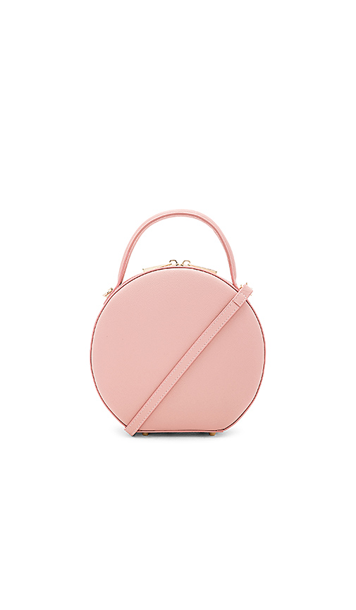 Circle Bags - We've seen the woven version all summer long so it's not surprise the circle bag trend will be carried into the cooler months. Now, with more lush fabrics and a variety of colors.