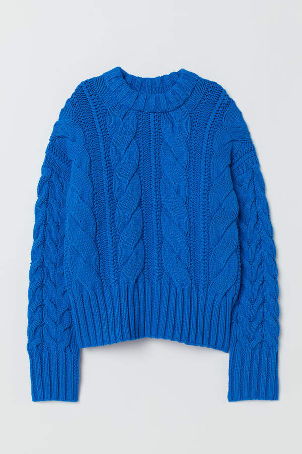 BLUE CABLE-KNIT SWEATER - How fun is this bold blue hue? Perfect paired with denim or dress up a bit with a midi skirt.