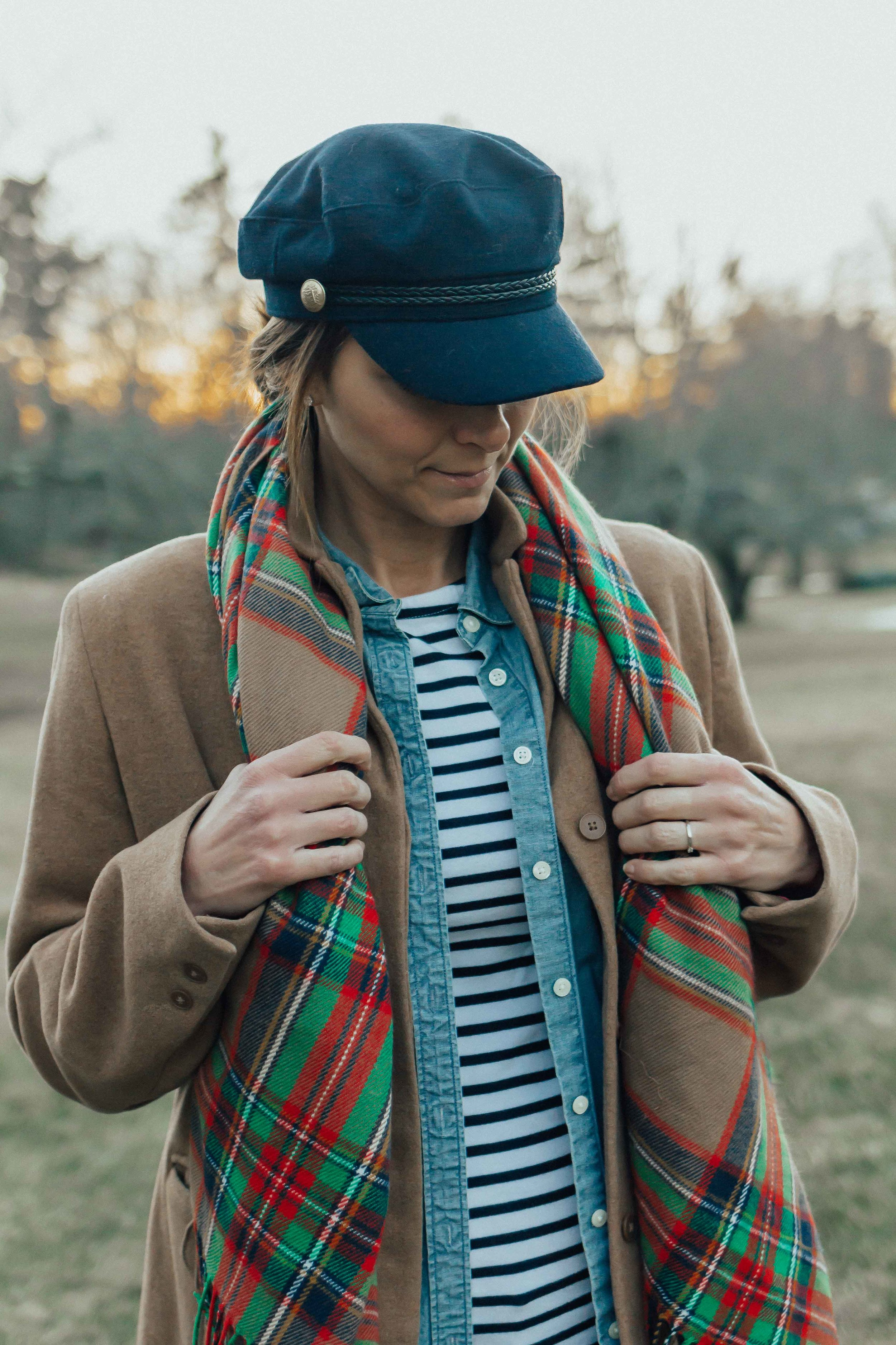 What I'm Wearing - CHAMBRAY BUTTON-UPBLANKET SCARFCAPTAINS CAP (similar)STRIPED TEEDENIMCAMEL COAT (similar)WOOL SOCKSBEAN BOOTS
