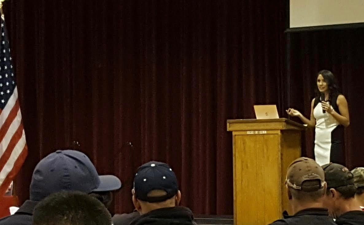 """AXS Wellness founder Jacqueline Davis delivering a keynote address: """"Sleep Loss is Killing Firefighters"""" at the Colorado Firefighters Academy Conference 2016."""