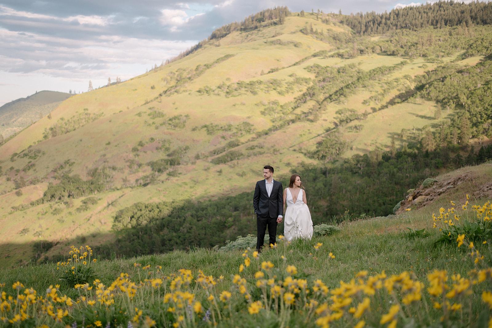 Bride & Groom among wildflowers at Rowena Crest
