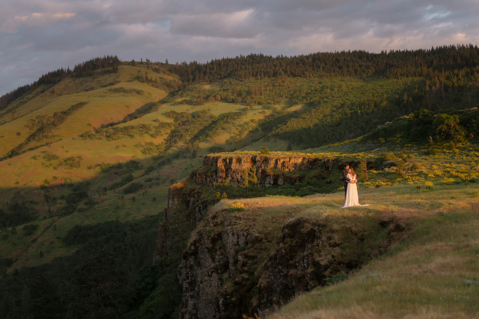 Rowena Crest at sunset with bride & groom