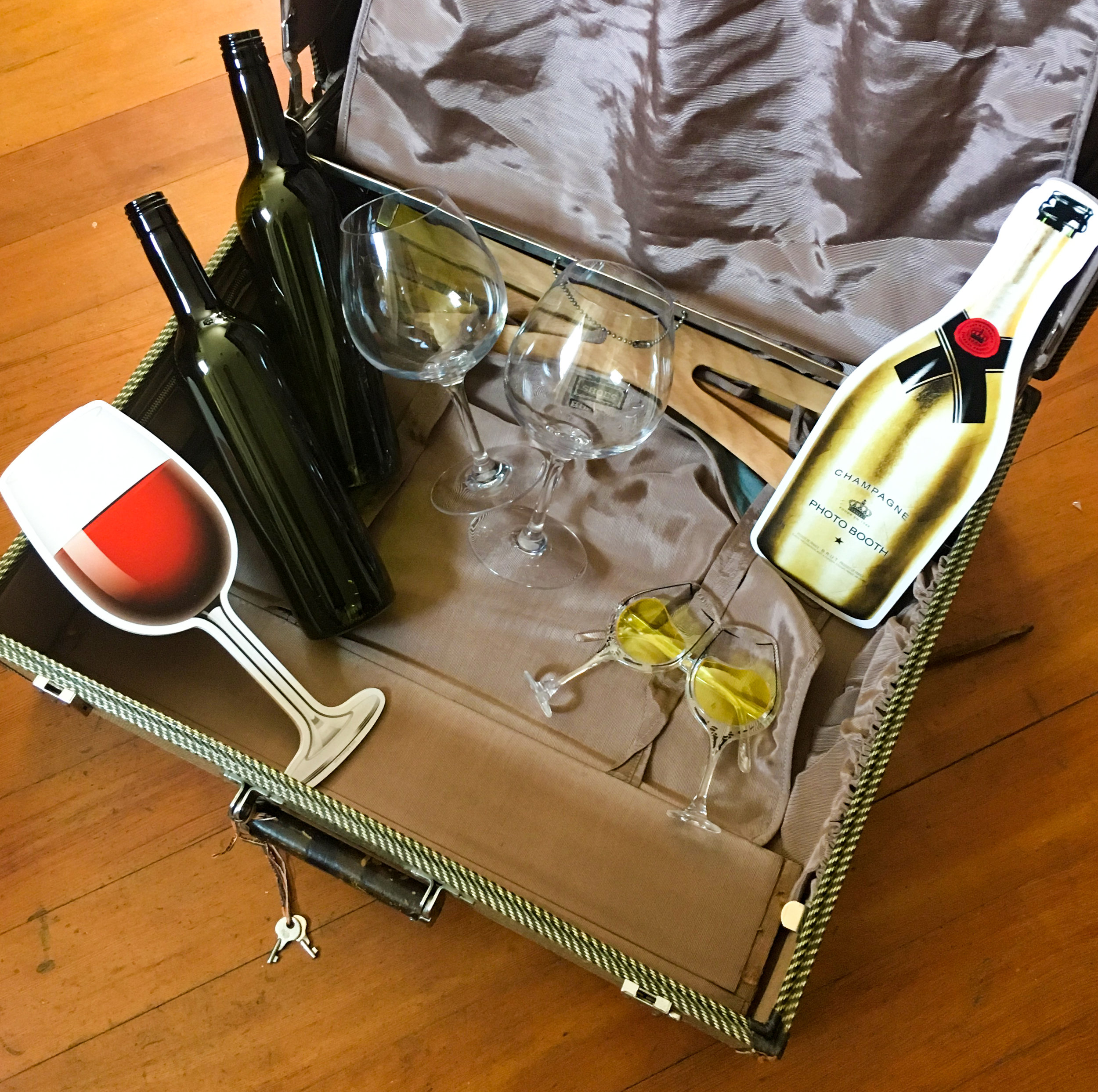 Wine Country Props - Hand-selected props from those in the know! Grapes,chalices, wine glasses, inflatable champagne bottle, wine bottles, wine sunglasses, wine glass signs, green & clear wine bottles, wine country-themed stick props!