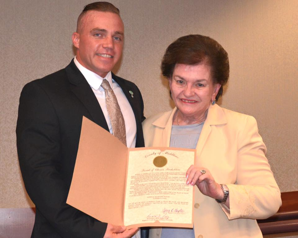 Joel with Middlesex County Freeholder Blanquita Valenti receiving the proclamation marking September as Recovery Month.