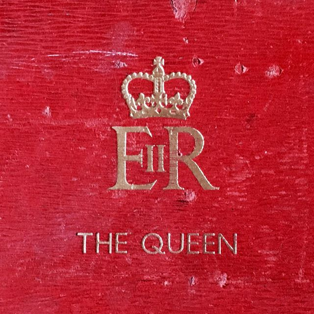 Embossed in gold on an old red leather despatch box, The Queen and Her Majesty's cypher. #despatchbox  #queenelizabeth #eiir