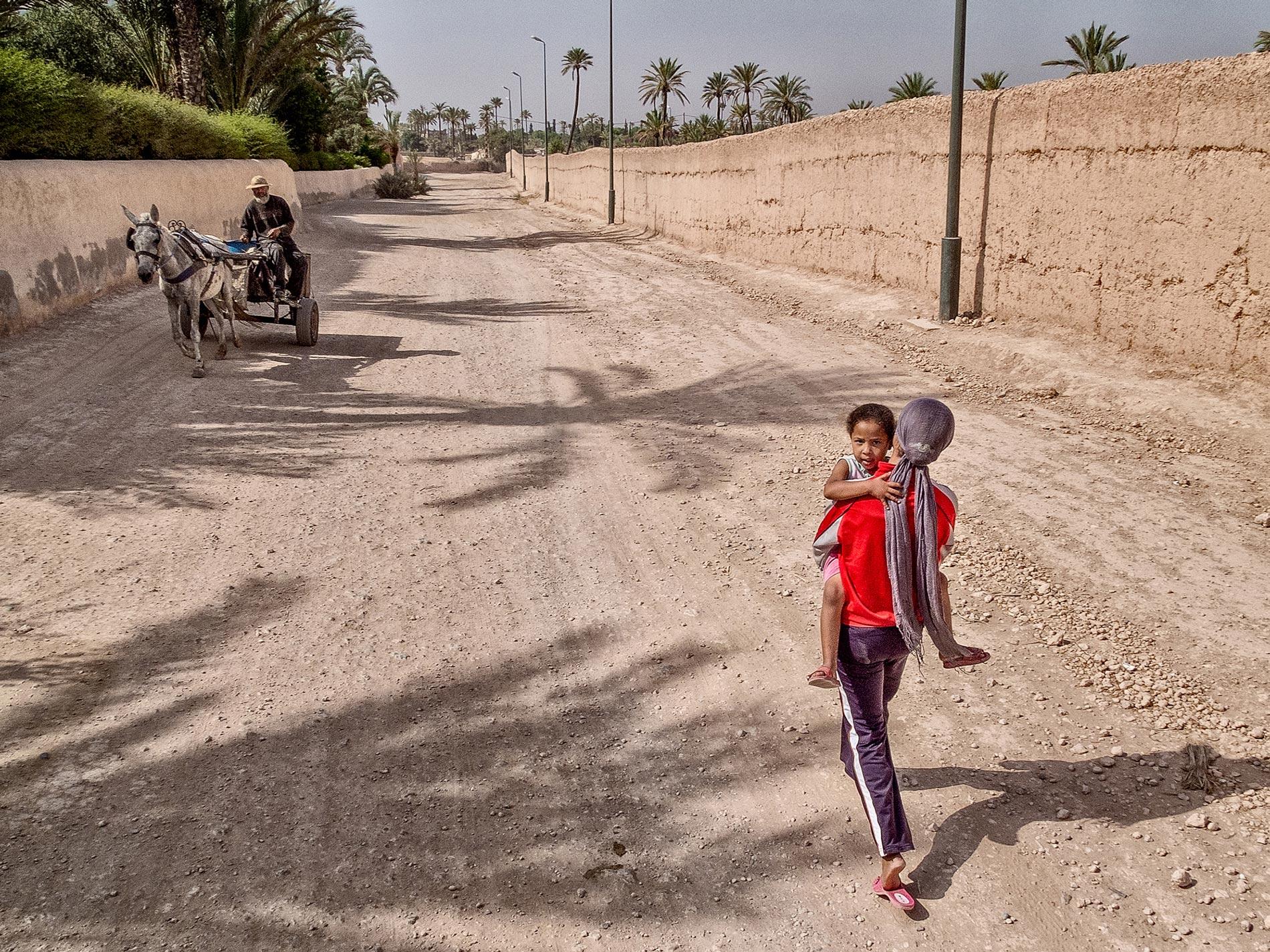 Girl, child, man and donkey - Marrakech